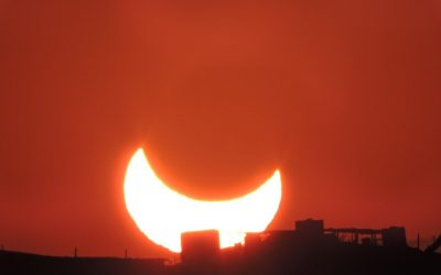 The moon blocks the golden sun from the earth in a wonderful view of the eclipse